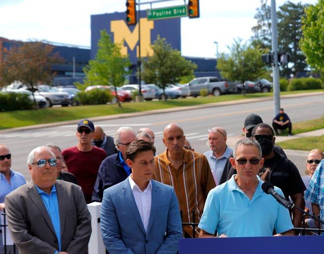 Tad DeLuca, a former Michigan wrestler, talks to the media on Wednesday.