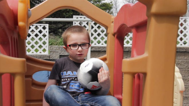 Will Clark, 5, plays outside at his Oxford home. Will, a preschool student who is on the autism spectrum, had difficulty adapting to online learning during the COVID-19 pandemic.