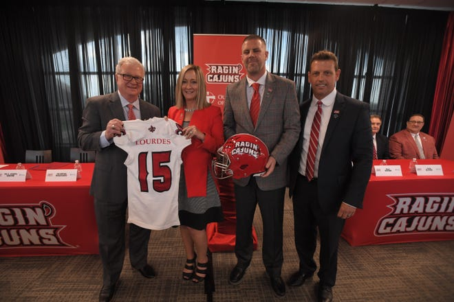 UL president Joseph Savoie (left), hospital administrator Kathy Healy-Collier, coach Billy Napier and athletic director Bryan Maggard pose after it was announced Our Lady of Lourdes has acquired Cajun Field naming rights.