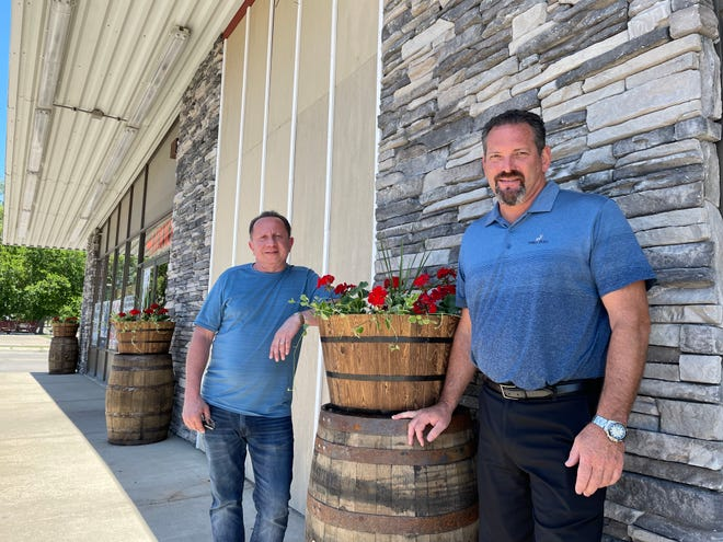 Canopy Bottle and Gourmet Shoppe owner John Kallabat, left, and custom builder Bill Opre are renovating a space next to the liquor store for a new high-end lounge, The Canopy Lounge, shown Wednesday, June 16, 2021.