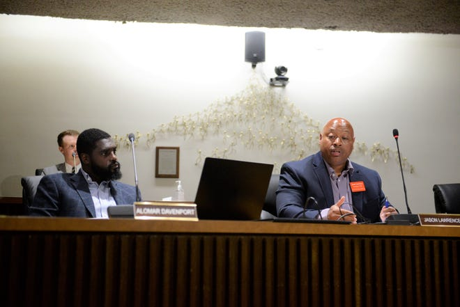 Councilman Jason Lawrence, right, of the Fifth Ward tried to force a vote Tuesday on legislation to design the North Lake Park Dry Dam flood-mitigation project, better known as the dry dam.