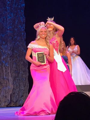 Miss Miami Valley's Outstanding Teen Madison Yuzwa, 18, of Broadview Heights, is the new Miss Ohio's Outstanding Teen. Outgoing winner Madison Defrank, pins her crown on Tuesday night at the Renaissance Theatre.