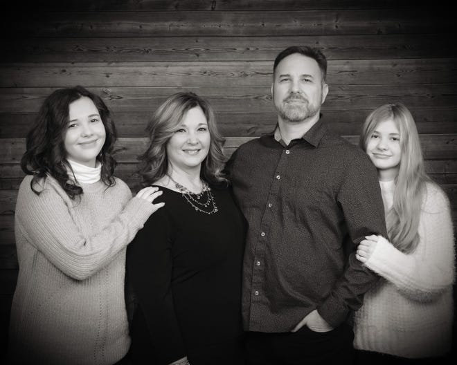 In this family portrait are Eliana Bush, Lisa Bush, Eli Elmore Anthony Bush V, and Hannah Bush. Lisa Bush is a co-owner and wealth advisor with Alluvial Private Wealth in downtown Marion. Eli works for the Social Security Administration. Hannah is a student at Grant Middle School. Eliana is a student at Harding and also takes classes at Marion Technical College through the College Credit Plus program.