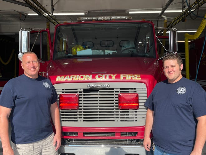 Mike Makowski (left) and his son Corey Makowski stand as the second and third generation of Makowskis who have worked at the Marion City Fire Department.
