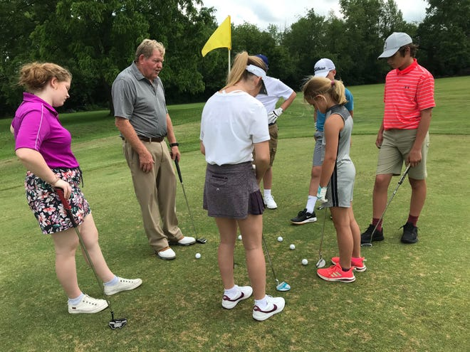 Marion County teaching golf professional Steve Grimes gives a clinic for youth golfers as part of the Heart of Ohio Junior Golf Association's camp held last week at Determined Brilliance Driving Range in Marion.