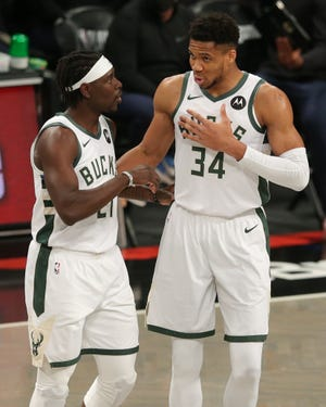 Bucks point guard Jrue Holiday and forward Giannis Antetokounmpo were part of the NBA's all-defensive first team. Holiday was acquired in a trade last offseason with New Orleans, while Antetokounmpo, who is in his eighth season with the Bucks and the face of the franchise, signed a five-year extension worth $228 million in December.