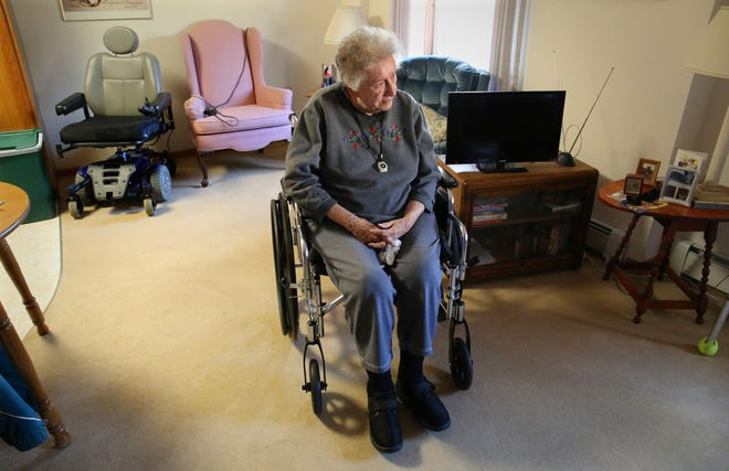 Audrey Brennan, 86, sits in her apartment at Juniper Court, an elderly housing complex on S. Lake Drive in St. Francis. Brennan led a rich social life, even after her husband died, but everything changed three years ago when she fell and broke the ball socket of her hip.