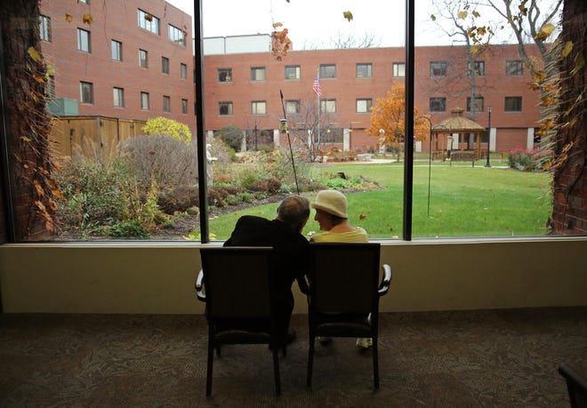 Former Wisconsin Gov. Martin Schreiber and his wife, Elaine, look out on the courtyard at the Lutheran Home on W. North Ave. in Wauwatosa, where she now lives. Elaine Schreiber has Alzheimer's disease and Martin has felt her slipping away from him as the disease has progressed.