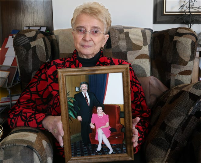 Sandy LaRosa holds a photo of her and her husband, Tom, now deceased, from the mid 1990's, in her home in Milwaukee. Tom, a diabetic, began using Victoza in 2010 to control his blood sugar with the hope it would help him lose weight. He died in January of pancreatic cancer, a potential concern with Victoza and a higher-dose weight-loss version, Saxenda.