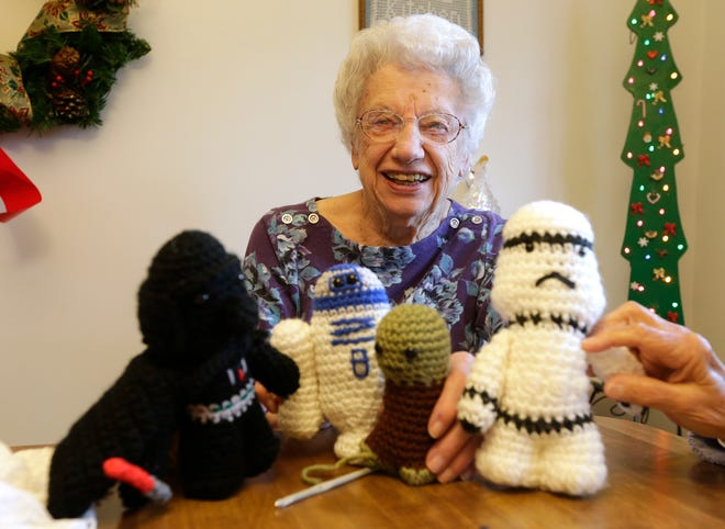 """MIKE DE SISTI Mildred Schumacher holds a collection of characters from the movie """"Star Wars"""" that she made for a family member."""