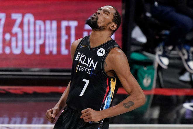 Brooklyn Nets forward Kevin Durant reacts after sinking a 3-point shot against the Milwaukee Bucks during the fourth quarter of Game 5 of a second-round NBA basketball playoff series Tuesday, June 15, 2021, in New York. (AP Photo/Kathy Willens)