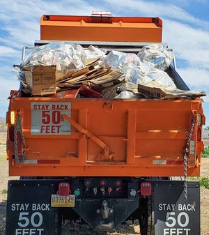 New Mexico Dept. of Transportation employees collected 36,000 pounds of trash in a single day.