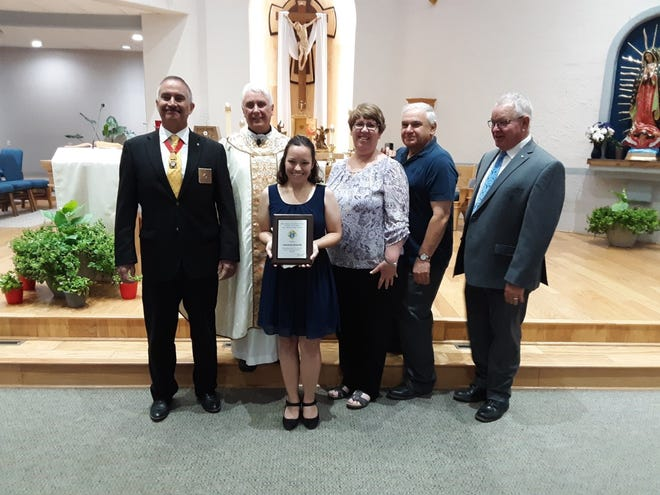 Anastasia Kinsella of Las Cruces was chosen as the New Mexico State Council of the Knights of Columbus' Catholic Girl of the Year for the Fraternal year 20/21. Pictured from to right are Knights of Columbus State Deputy Daniel Vigil, Fr. Richard Catanach, Anastasia Kinsella, Jeanne Kinsella, Bill Kinsella and Grand Knight of Council 9527 Randy Boyer.