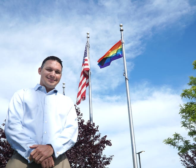 Westland City Council approved a resolution recognizing June as Pride Month. Council President Pro Tem Mike Londeau, who put the item on the agenda, stands in front of city hall with a Pride flag the city is flying on a mast.