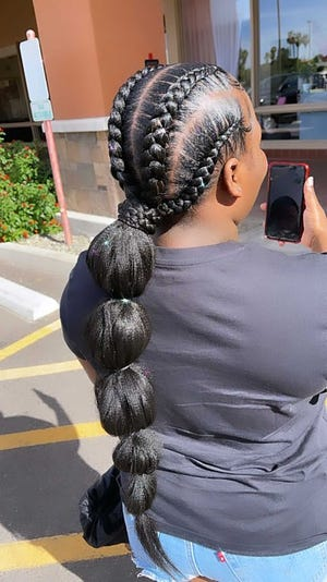 """Diamond Jones recommends the bubble ponytail as a """"really great style, no matter the type of (hair) texture,"""" for the summertime."""