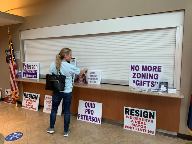 Morrison Ranch residents placed signs outside the June 15 Gilbert Town Council meeting to protest Mayor Brigette Peterson.