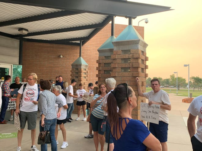 Residents line up outside Gilbert's June 15 Town Council meeting to oppose the Santan Adventure Park project.