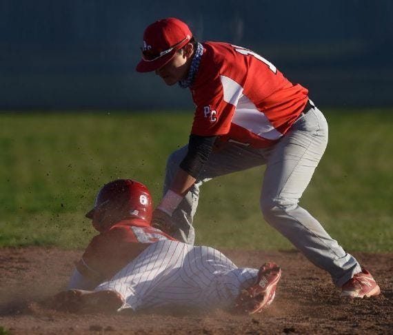 Port Clinton shortstop Braeden George puts a tag on a runner.
