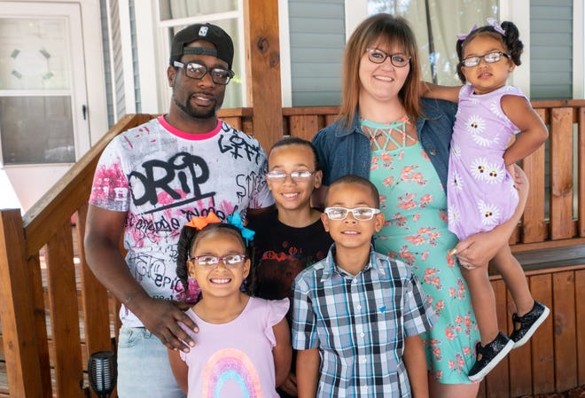 Robert and Katelin Walker pose for a portrait with their kids Jackson, 9; Julius, 10; Nia, 7 and Collise, 2, Wednesday, June 16, 2021, at their home in Port Huron. The mixed family will be celebrating Juneteenth by throwing a party for their friends, family and community.