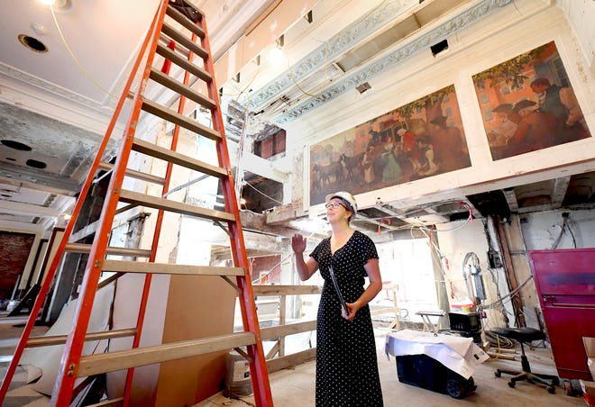 Kimberly Hogeman, York County Economic Alliance strategic development director, talks about progress of the Yorktowne Hotel construction in the lobby area of the historic downtown landmark Tuesday, June 15, 2021. A 1926 triptych mural, background, will be rejoined and retained in the front desk area. Bill Kalina photo