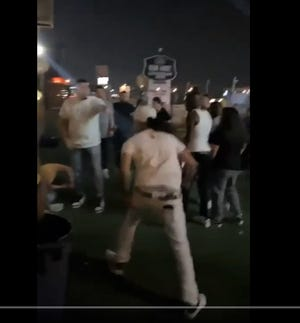 A brawl involving a man in a white cap apparently armed with a knife at the Good Times at 2626 bar was captured on cellphone videos on June 6, 2021. This is image is from a video shared by FitFam El Paso.