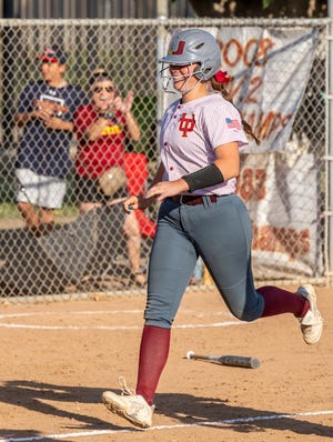 Tulare Union's Taylor Hastin scores on a home run to defeat Mission Oak in a Central Section Division III semifinal game Tuesday, June 15, 2021.