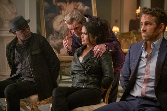 Antonio Banderas (center) stars as a Greek villain with a nefarious plan that a hitman (Samuel L. Jackson), his wife (Salma Hayek) and a bodyguard (Ryan Reynolds) have to stop in