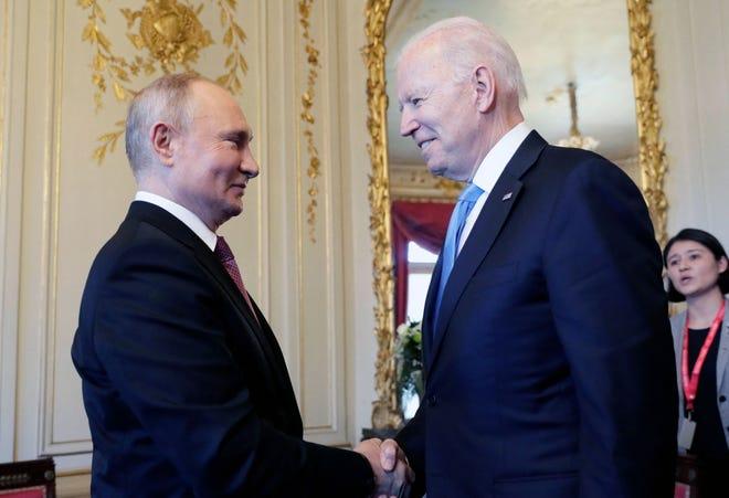 Russian President Vladimir Putin shakes hands with President Joe Biden during their meeting at the 'Villa la Grange' in Geneva, Switzerland on June 16, 2021.