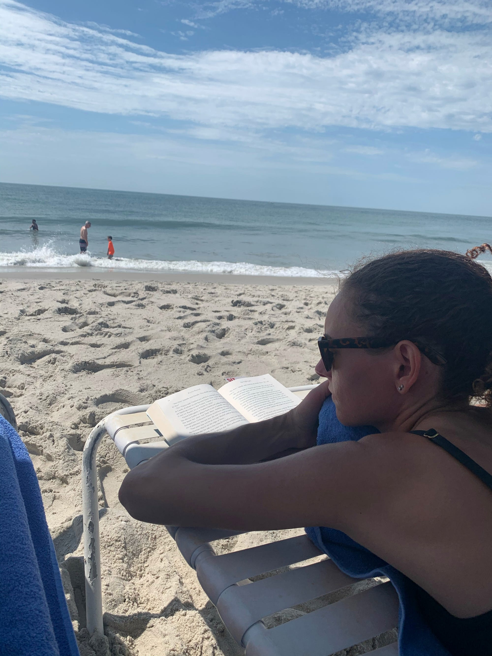 Phil Dengler's girlfriend, Robin England, lounges on the beach during their trip to Cape May, New Jersey, in June 2020.