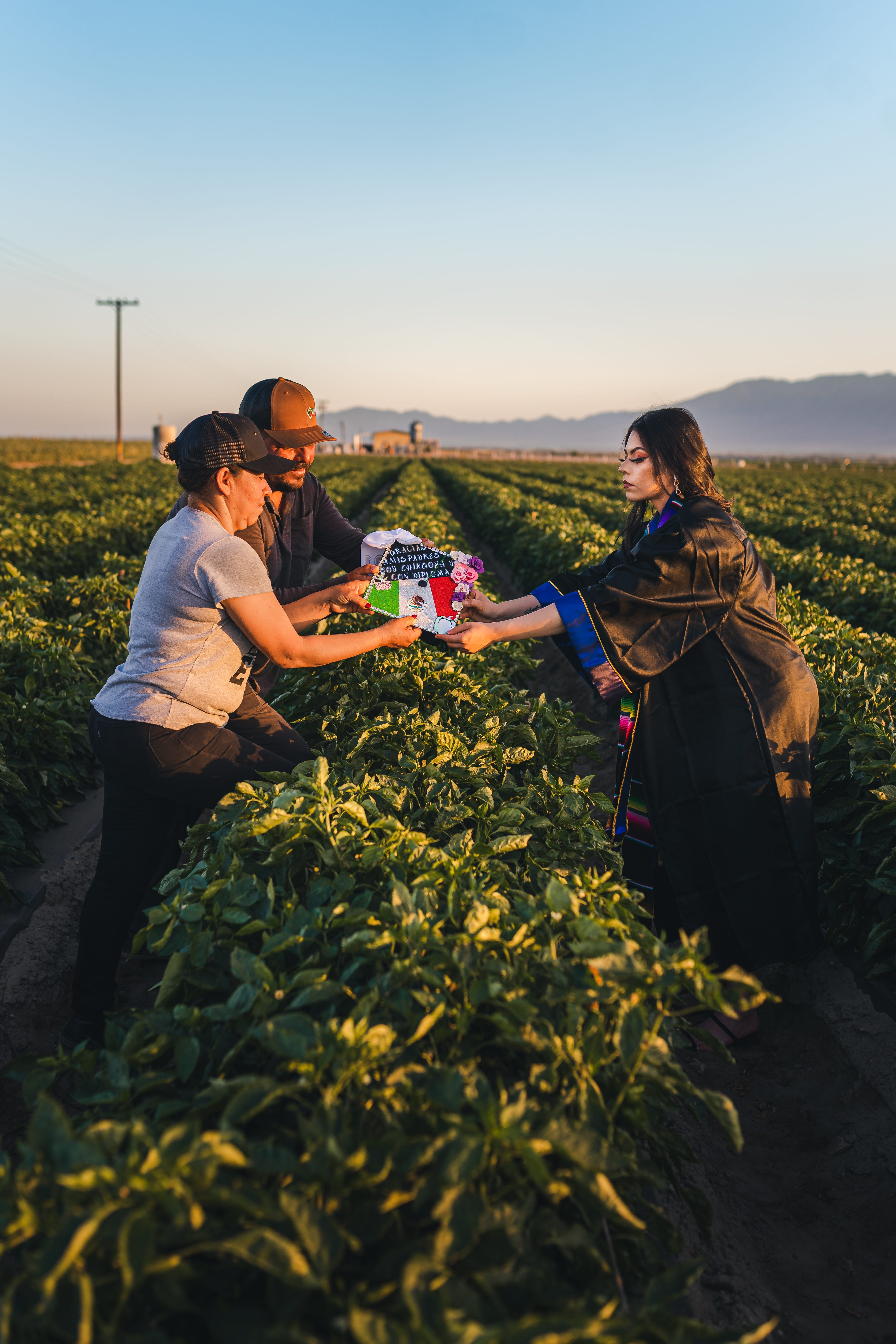 California graduate honors immigrant parents with senior photo shoot in strawberry fields