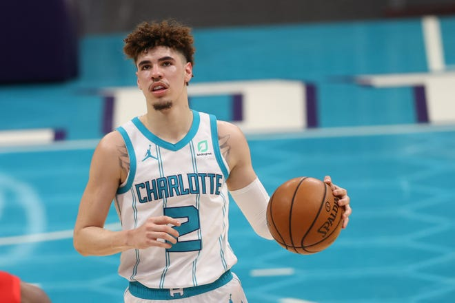 Charlotte Hornets guard LaMelo Ball (2) brings the ball upcourt against the New Orleans Pelicans in the second half at Spectrum Center this season. Ball was the No. 3 pick in last year's NBA draft and was named Rookie of the Year this season.