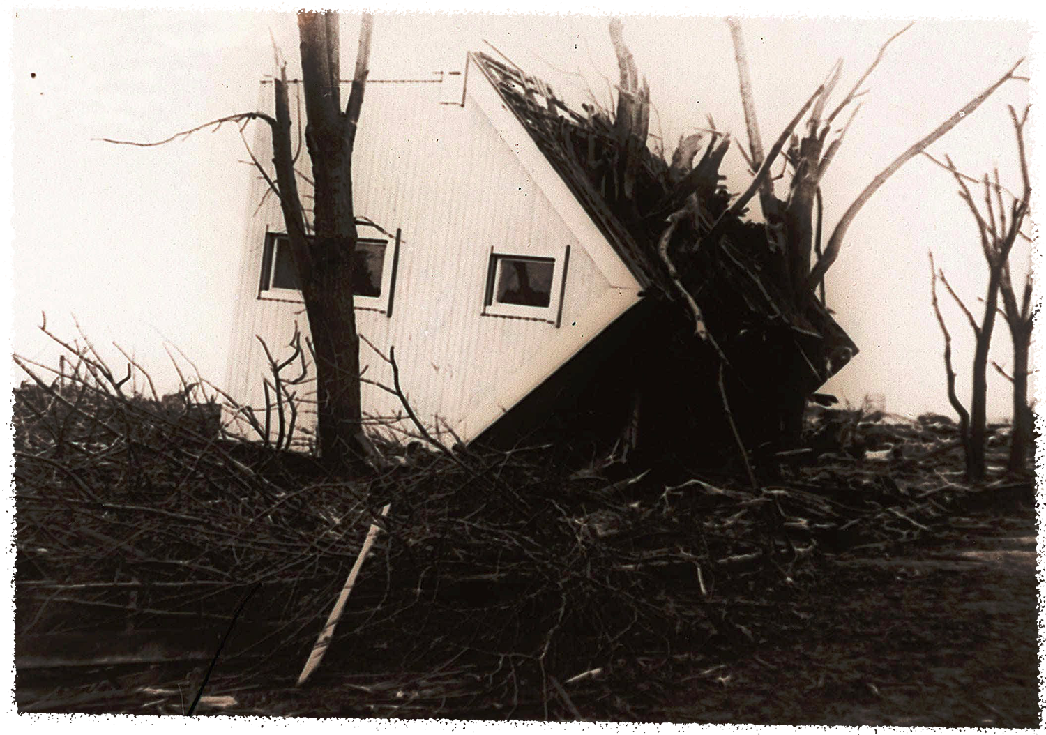 A March 21, 1925 photo of an overturned house that was carried more than 50 feet from its foundation by a tornado at Griffin, Indiana. There were 54 dead and about 200 injured of the town population of 400.