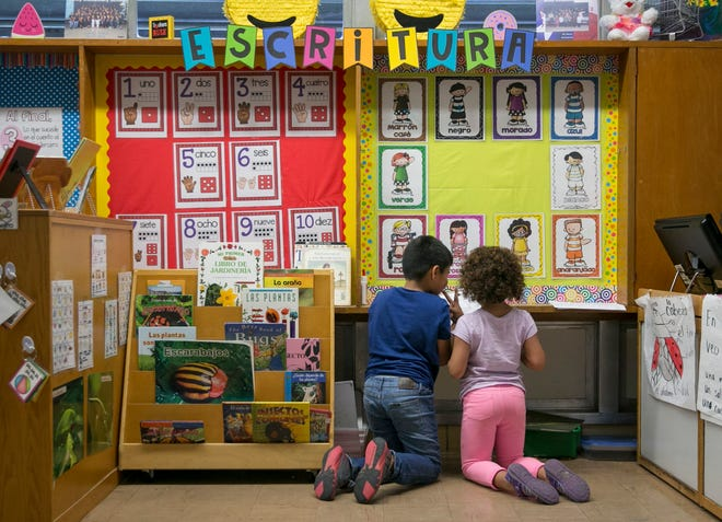 Two students are shown in 2019 in an English-Spanish dual language kindergarten class at Reilly Elementary School, one of the Austin schools that receives Title I funding for serving a large number of lower income students.