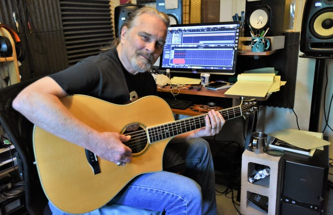 John Inmon, a heralded lead guitarist during Austin's Cosmic Cowboy music era, and in the ensuing decades, is pictured in his Blue Sugar Audio studio in his Bastrop home.