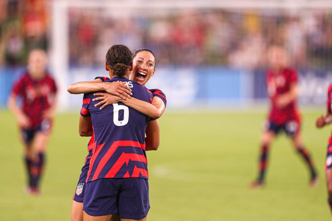 Christen Press smiles while celebrating the U.S. women's national team's second goal with teammate Lynn Williams. The U.S. defeated Nigeria 2-0 in the first game at the new Q2 Stadium on Wednesday.