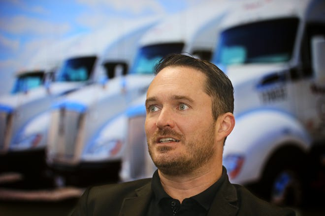 Ryan Richards, CEO of J. Rayl Transport talks Wednesday about the opening of its newly expanded/revamped headquarters in Akron.