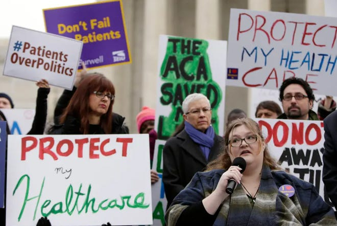 Demonstrators gathered in front of the Supreme Court in Washington, D.C., in 2015, to show support for the Affordable Care Act.