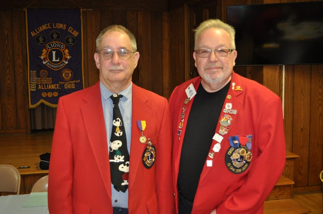 Lions Immediate Past District Governor Tony DeLuke, right, was on hand at a recent Alliance Lions Club meeting, and installed Jim Harshman, left, as the group's president.