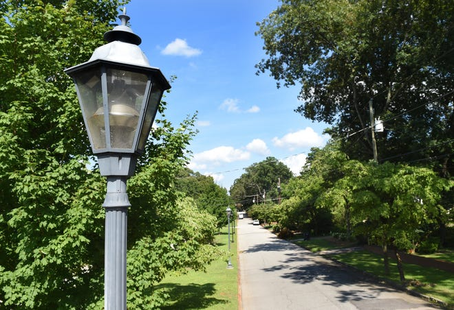 Decorative street lights line Henry Street in 2018. Augusta's streetlight program isn't uniform in structure and runs a large deficit. The Augusta Commission has struggled for years to address it.