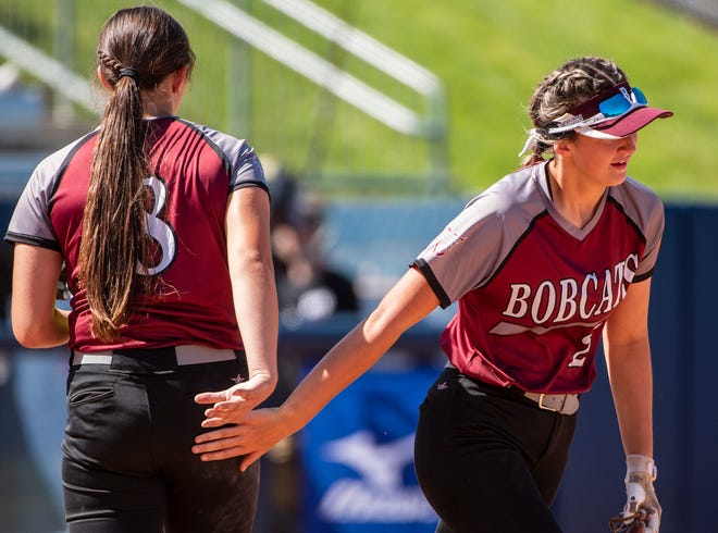 Beaver High School's Payton List, left, and her sister Chloe tap hands to start an inning against Tunkhannock in the PIAA 4A championship Thursday at Beard Field at Penn State University.[Lucy Schaly/For BCT]