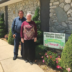 The Bartlesville Council of Garden Clubs presented its Beautification Award to Pastor Brian Fuller and his wife, Donna, at Truth Tabernacle Pentecostal Church on Nebraska Street.  The landscaping of evergreens and roses has beautified the neighborhood. The award was presented by Alison Treat and Diane Clark from the Green Thumb Garden Club.