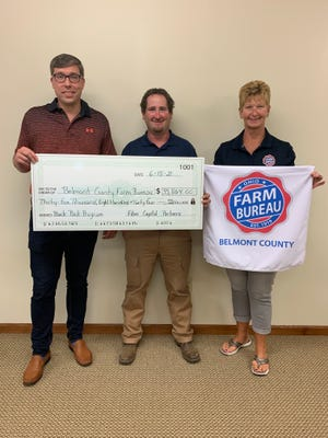 Pictured, l to, r are Nick Hunter, Belmont County GIG/Fiber Capital Partners; Devin Cain, Belmont County Farm Bureau Backpack Chair; and Betsy Anderson, Sr. Organization Director Ohio Farm Bureau
