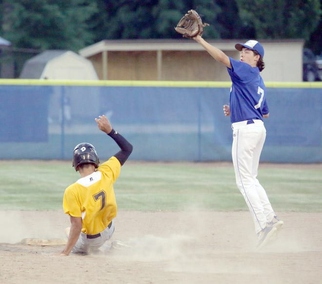 KWRT's Edrissa Bah goes low and New Franklin second baseman Sawyer Felten goes high for the ball during a steal attempt Monday night in Junior Babe Ruth action at Twillman field in Harley park. New Franklin avenged a 4-2 loss just last week against KWRT for a 6-5 victory.