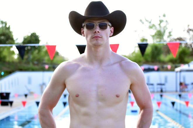 Former Missouri swimmer Micah Slaton poses for a photo June 10 at the Macher Aquatic & Fitness Center in Columbia.