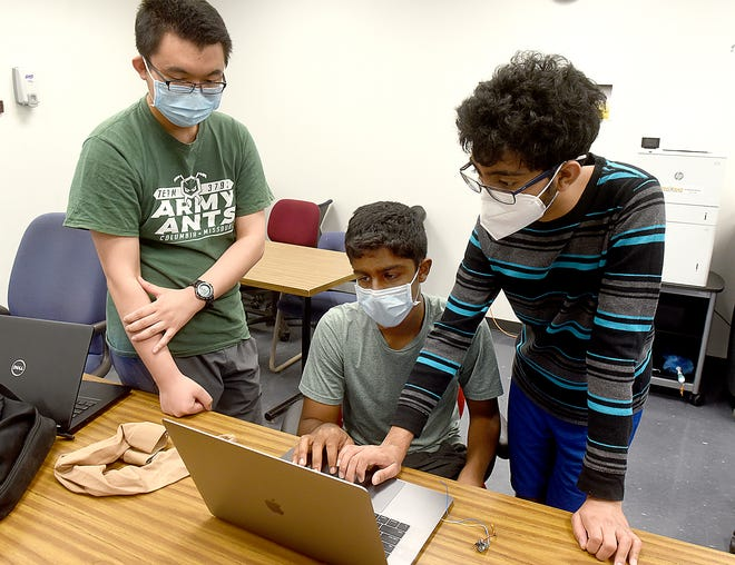Amy Ants youth robotics team members, from left, Zihao Zhou, 16, Akhilan Elangovan, 16, and Saathvik Kannan, 15, work on their inertial leg measurement sensor that includes a gyroscope and accelerometer.