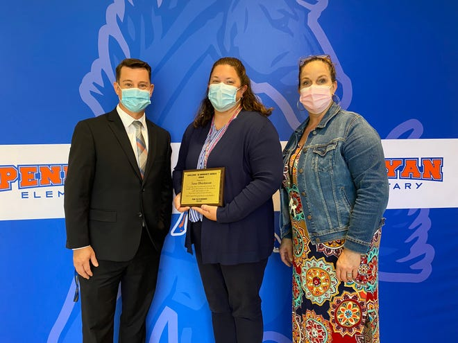 Penn Yan Elementary Principal Edward Foote presented the school's 2021 Excellence in Community Service Award to Sara Christensen, Deputy Director of Yates County Public Health (center). with them is Heather Neuberger, Penn Yan Elementary Awards Coordinator.