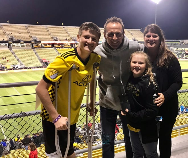 Brian Maisonneuve with his son, Jacob, daughter, Emma, and wife, Dianna, attending a Crew game as fans.