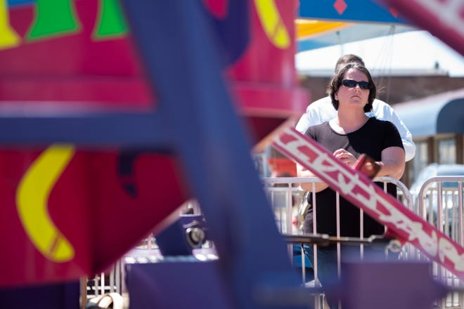 Amber Duffield, mother of Tyler Jarrell, watches during a press conference with the Ohio Department of Agriculture to highlight changes to amusement ride inspections on Thursday, June 17, 2021 in Mount Sterling, Ohio. After the passage of Tyler's Law in November 2020, safety and inspection measures have tightened. The law increases the frequency of ride inspections and documentation of rides operated outside of Ohio.