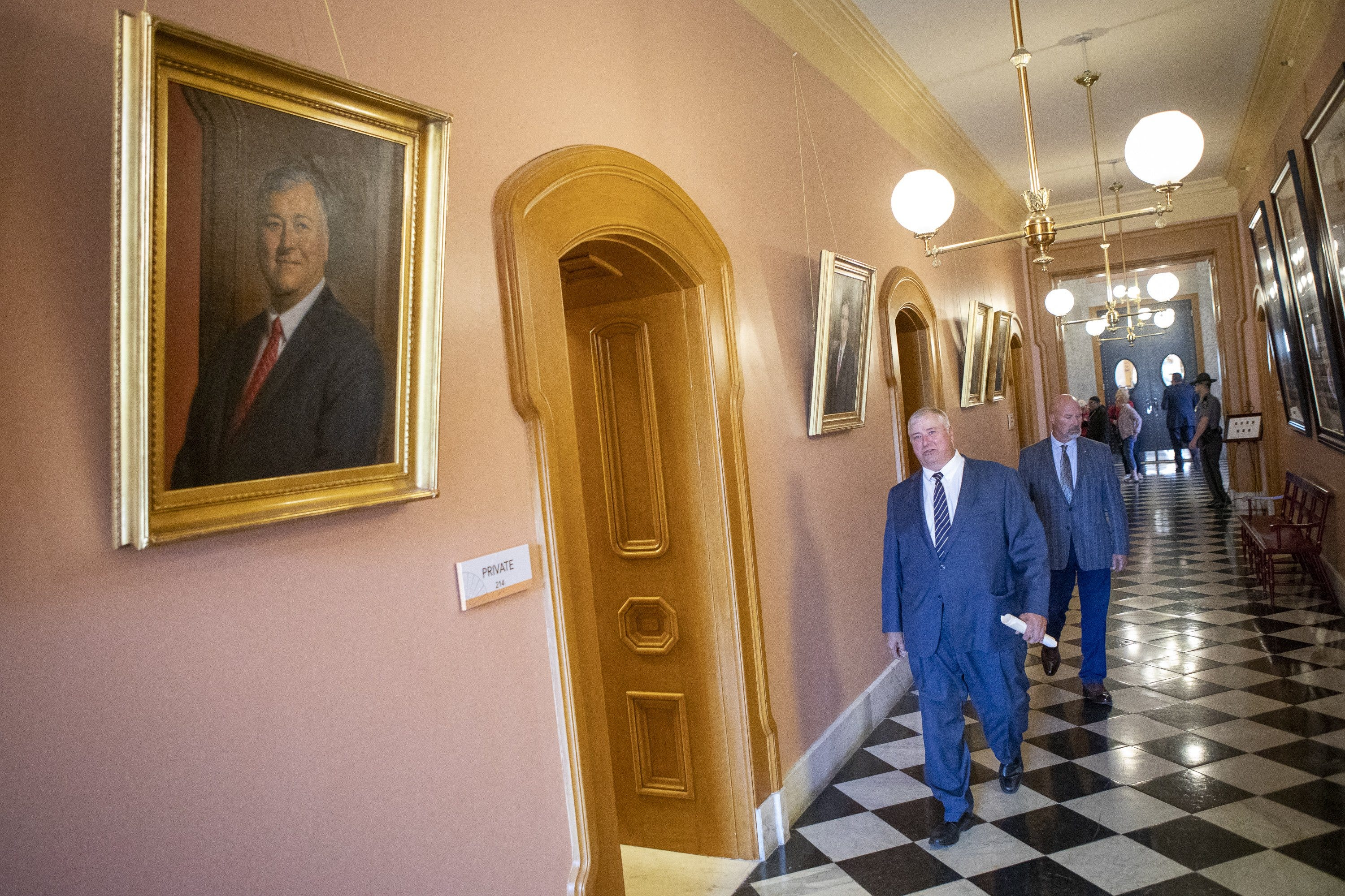 Rep. Larry Householder walks past his portrait after being expelled from the Ohio House at the Ohio Statehouse in Columbus on Wednesday, June 16, 2021.
