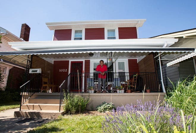 Alice Poindexter stands on the front porch of her home in Columbus earlier this month. Poindexter recently had her home re-sided through a grant from Nationwide Children's Hospital.